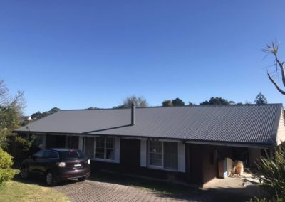 Here's a new roof flat metal roof with new gutters and downpipes