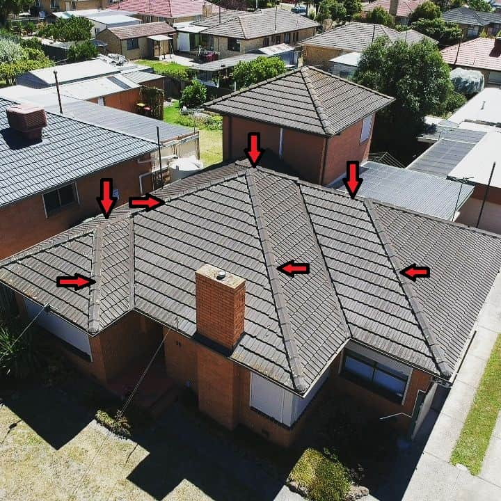 tiled roof with arrows for repointing
